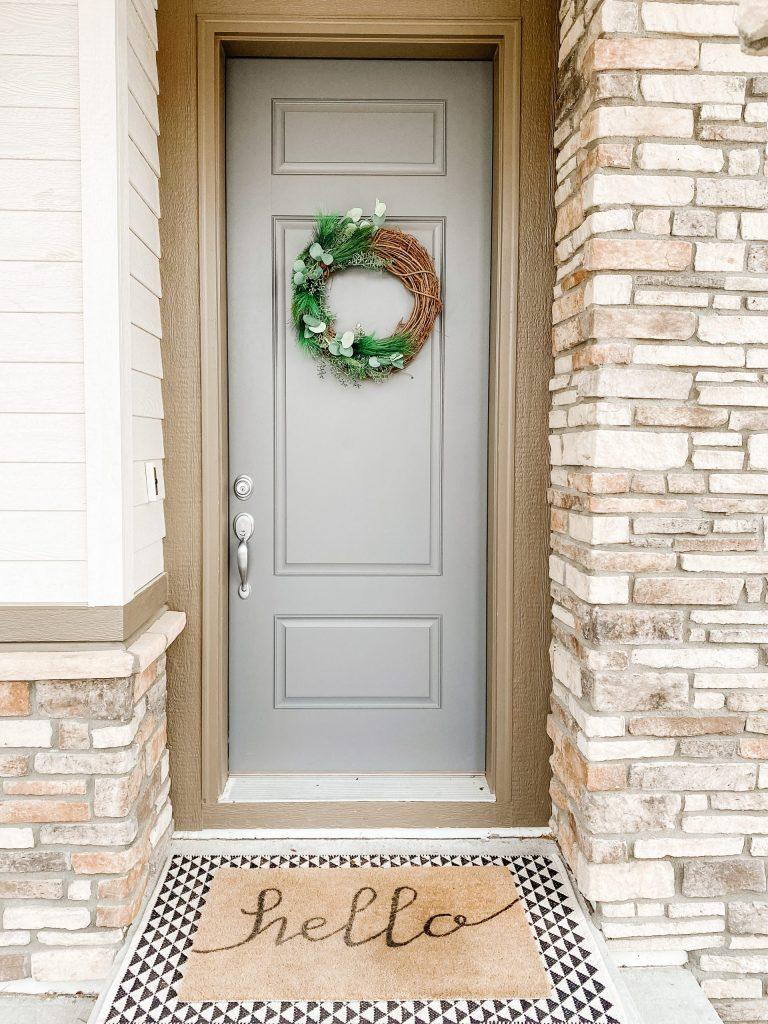 DIY winter wreath at front blue door