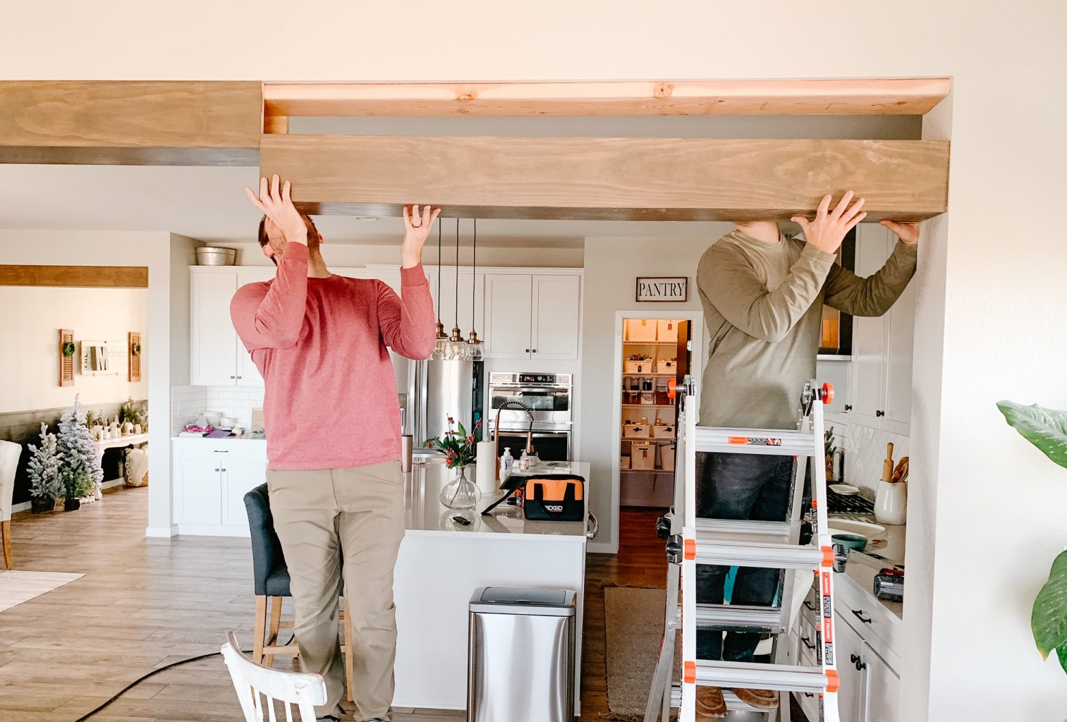 two men installing a faux wood beam