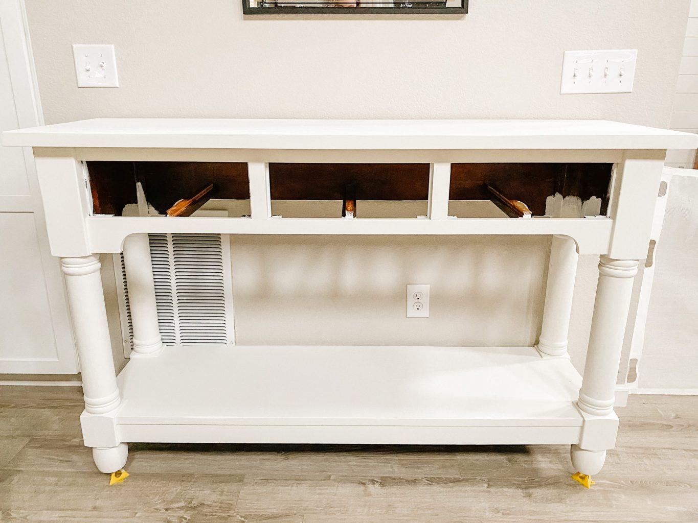 console buffet table after 3 coats of white chalk paint