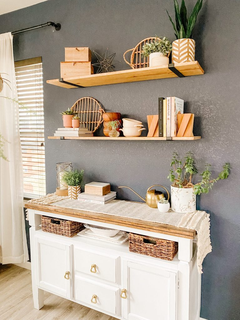 stained wood shelves with black brackets and white buffet cabinet