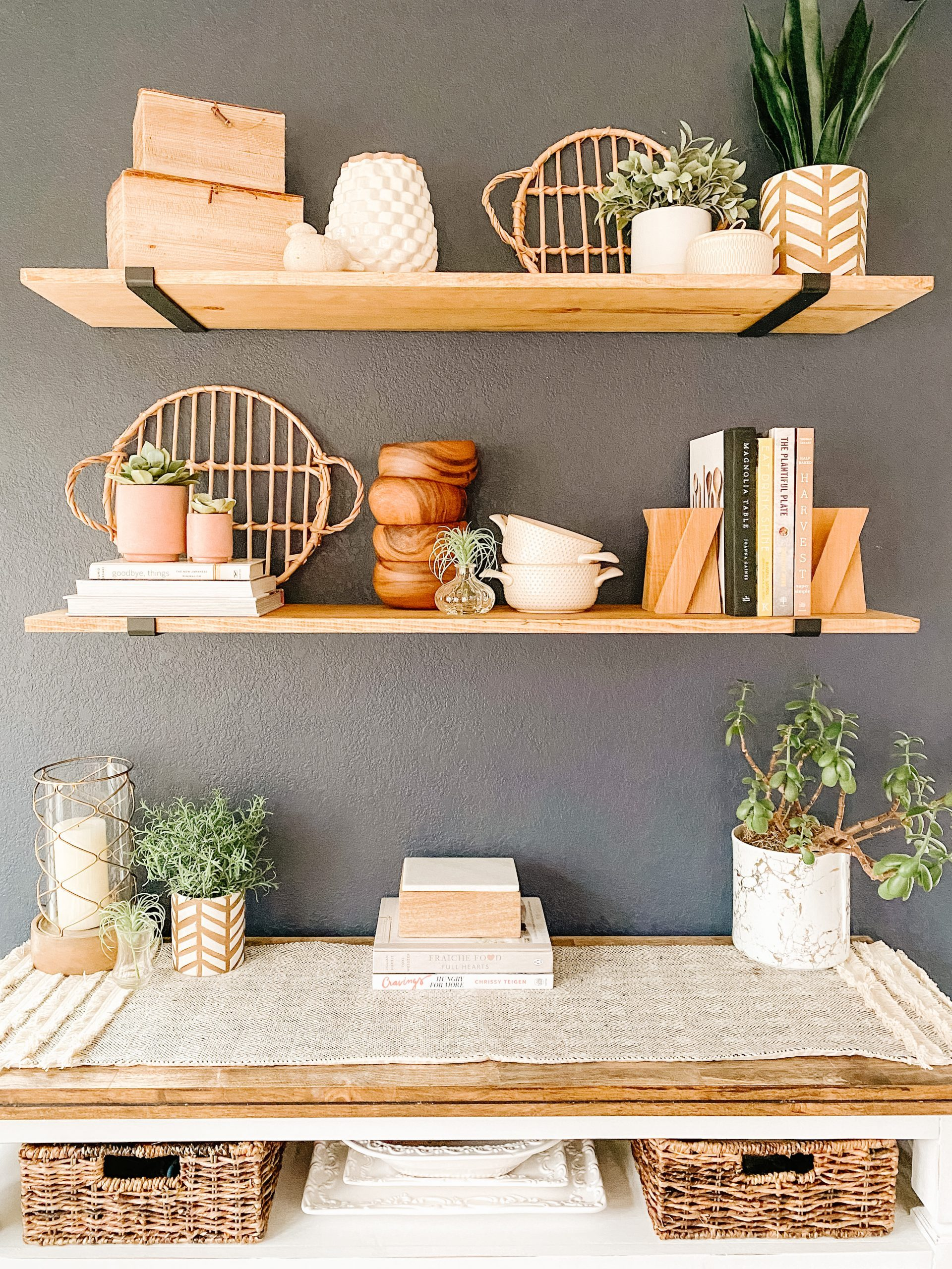 DIY wood wall shelves with black brackets on navy blue wall