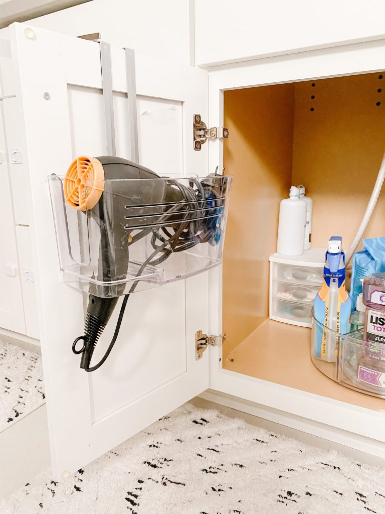 under-sink cabinet with organizers and hair dryer holder