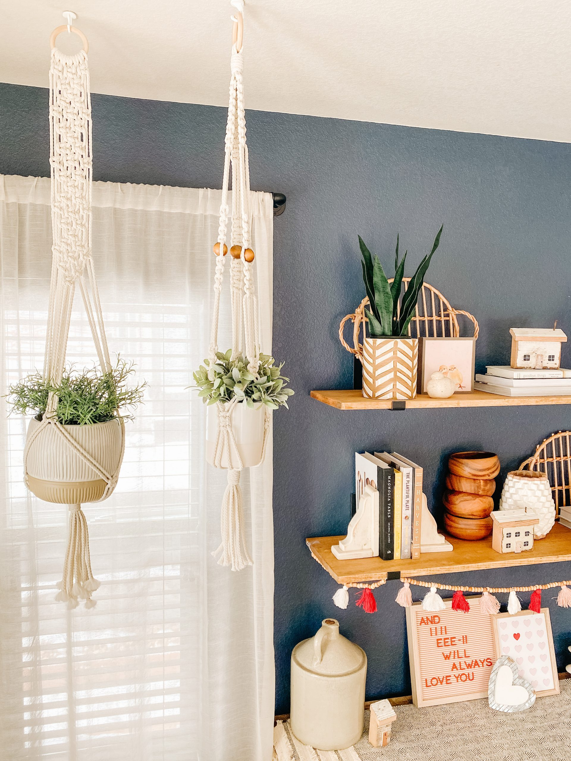 diy macrame plant hangers with navy wall and wood shelves