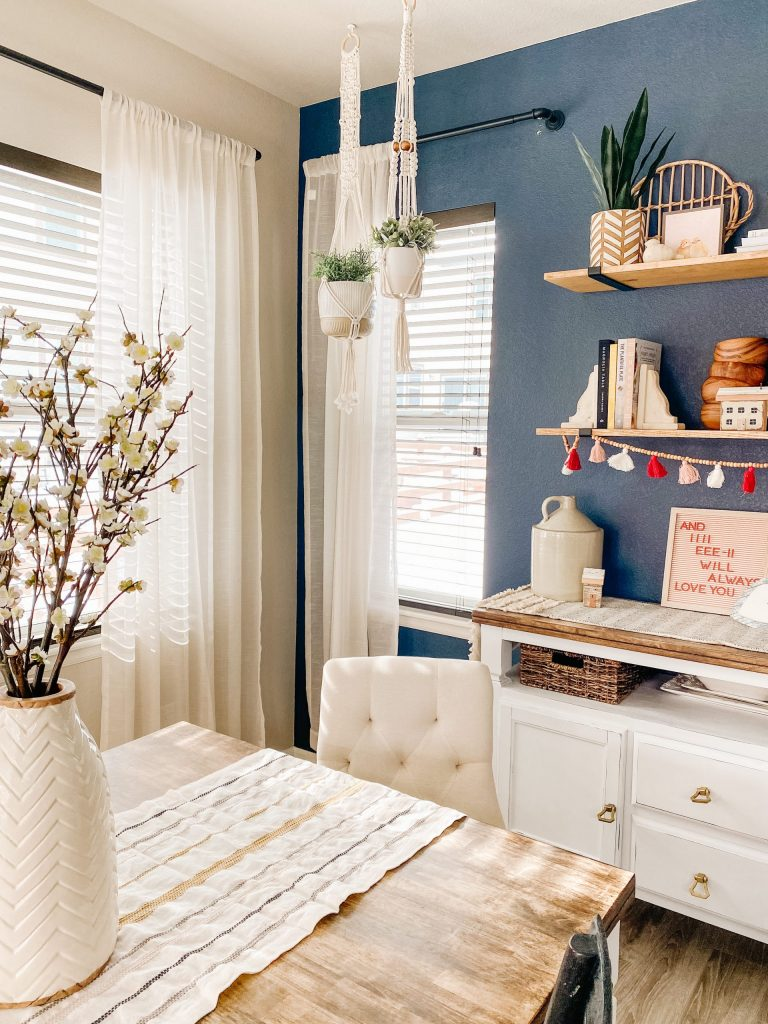 diy macrame plant hangers with navy wall and wood shelves and white vase