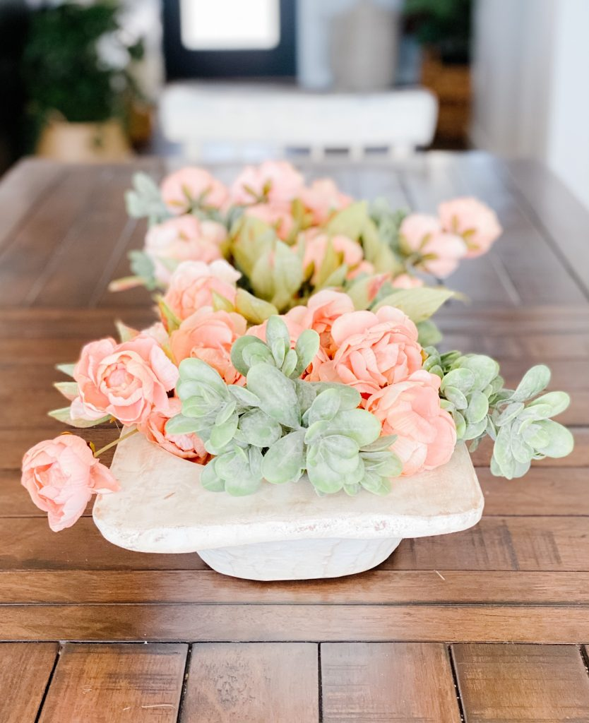Faux florals in a dough bowl for a pretty centerpiece for spring