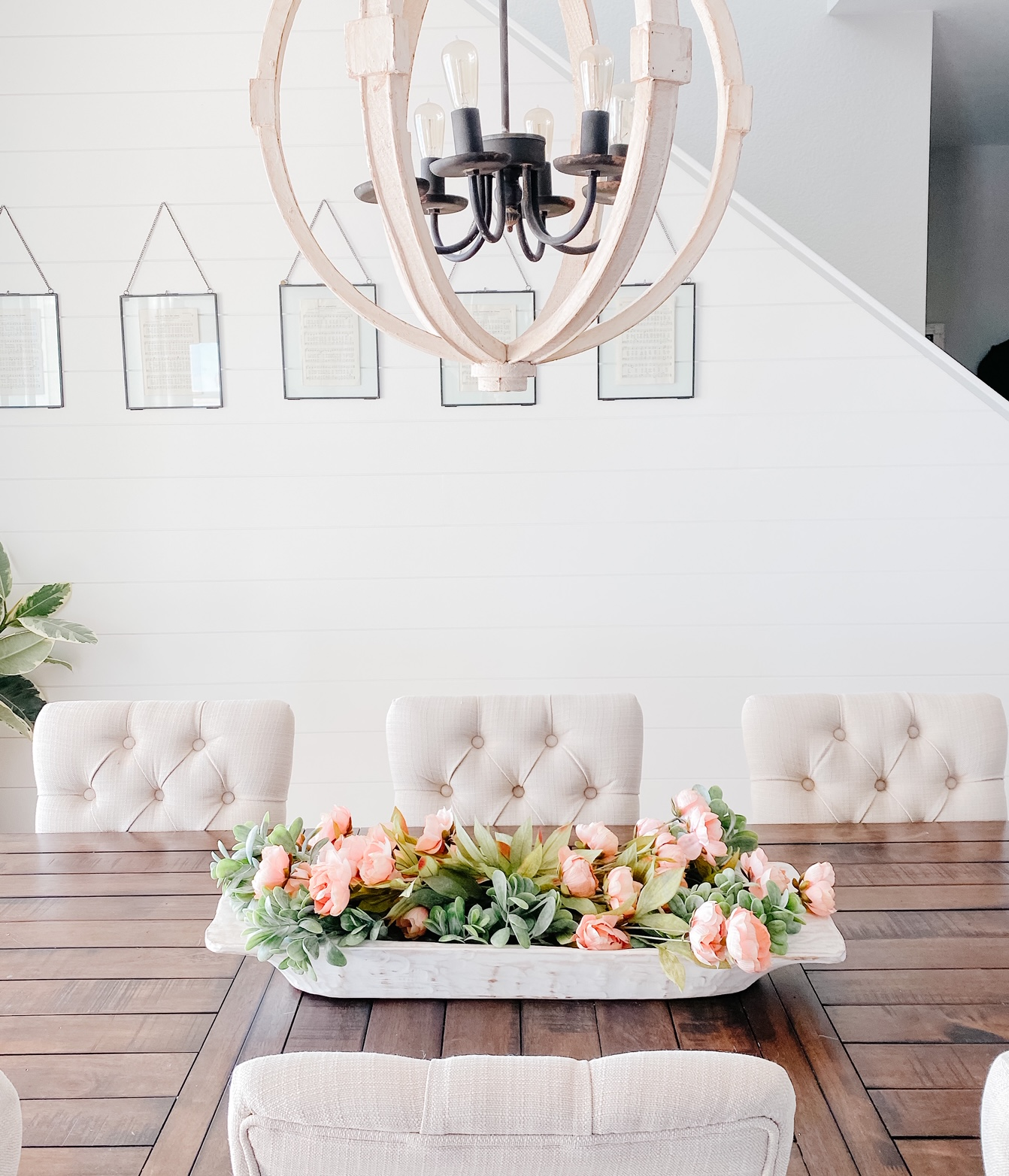 Faux spring florals in a dough bowl makes for a simple dining table centerpiece