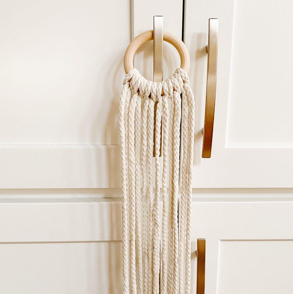 macrame top knots on wooden hoop