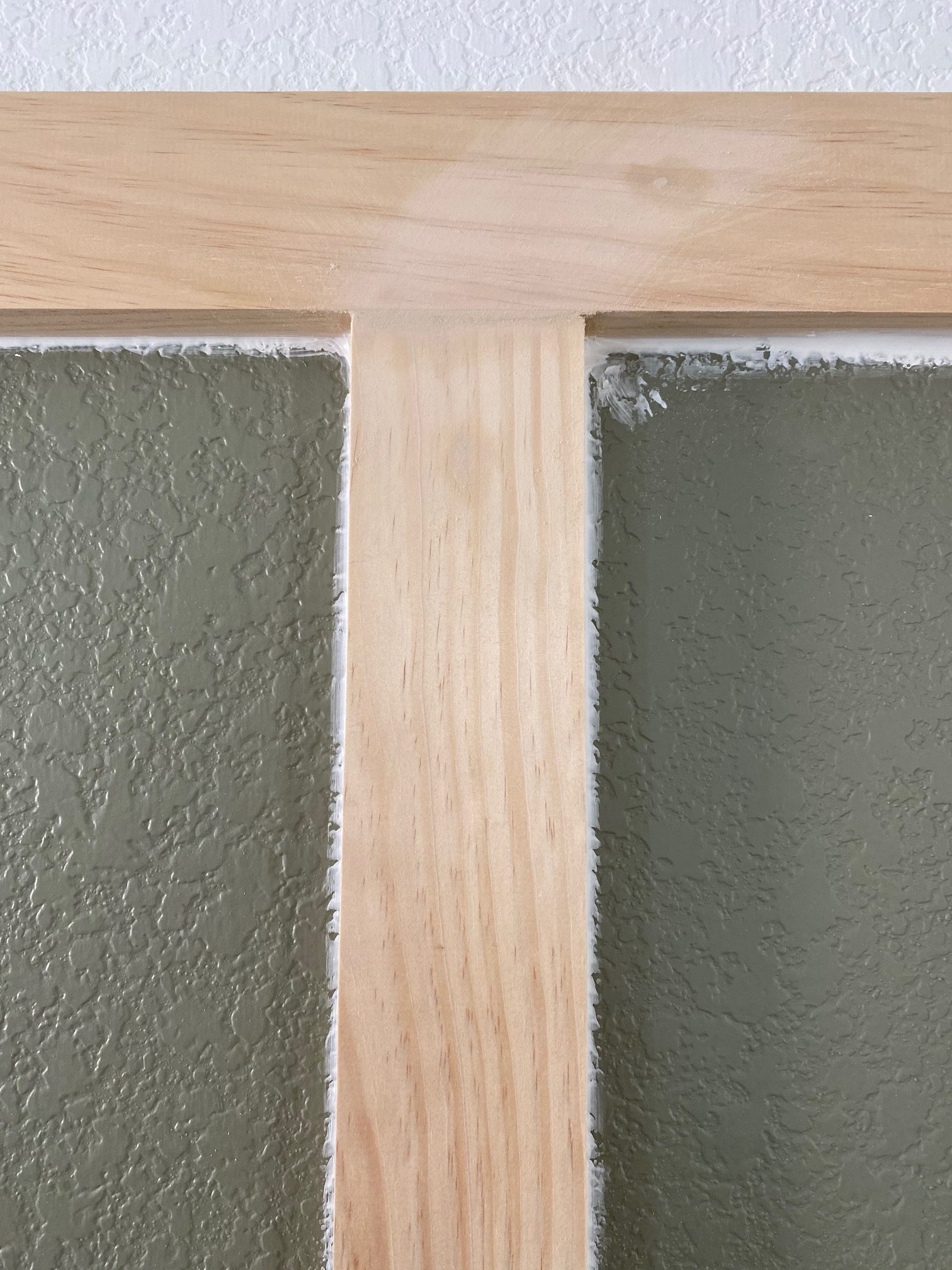 Board and Batten - A simple tutorial on how to DIY board and batten the easy way! Sanding down the spackle