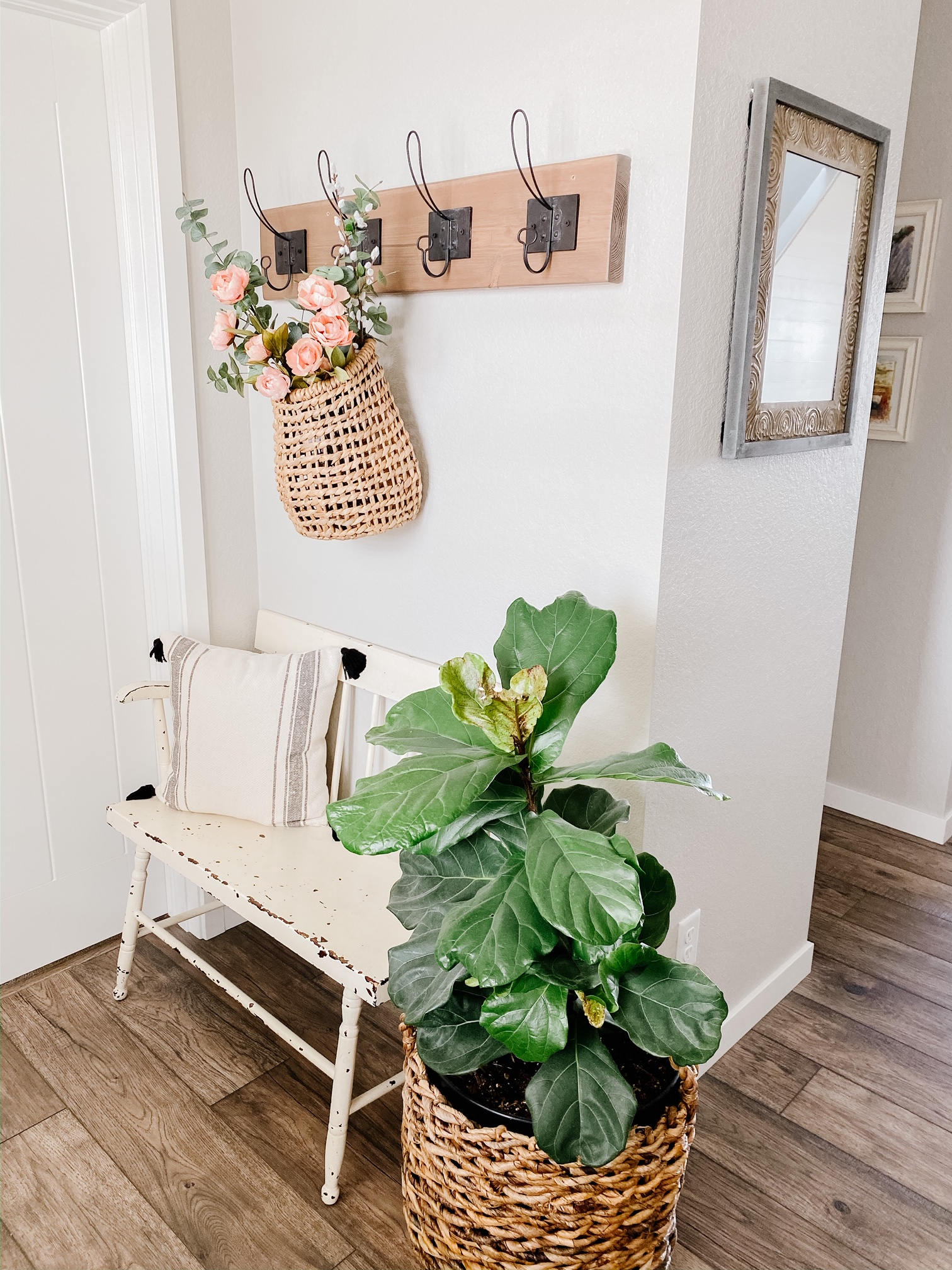 Faux Spring Florals In a hanging basket can add the perfect touch of spring to a coat rack or front door!