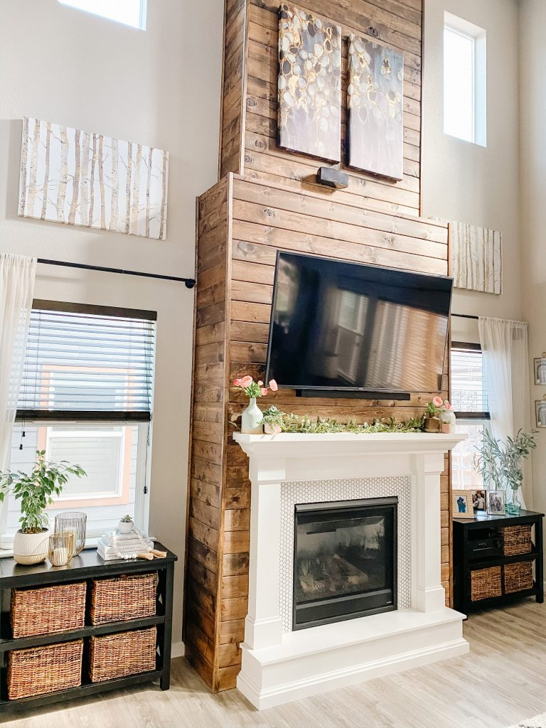 living room fireplace design with stained wood shiplap