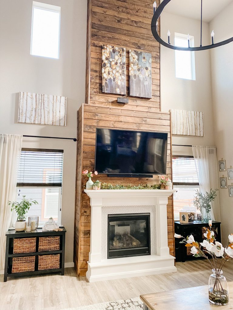 living room fireplace wall design with stained wood shiplap