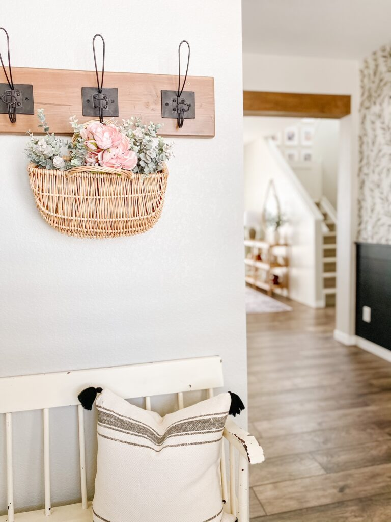 Spring florals in a basket hanging in the entryway adds a fresh spring feel!