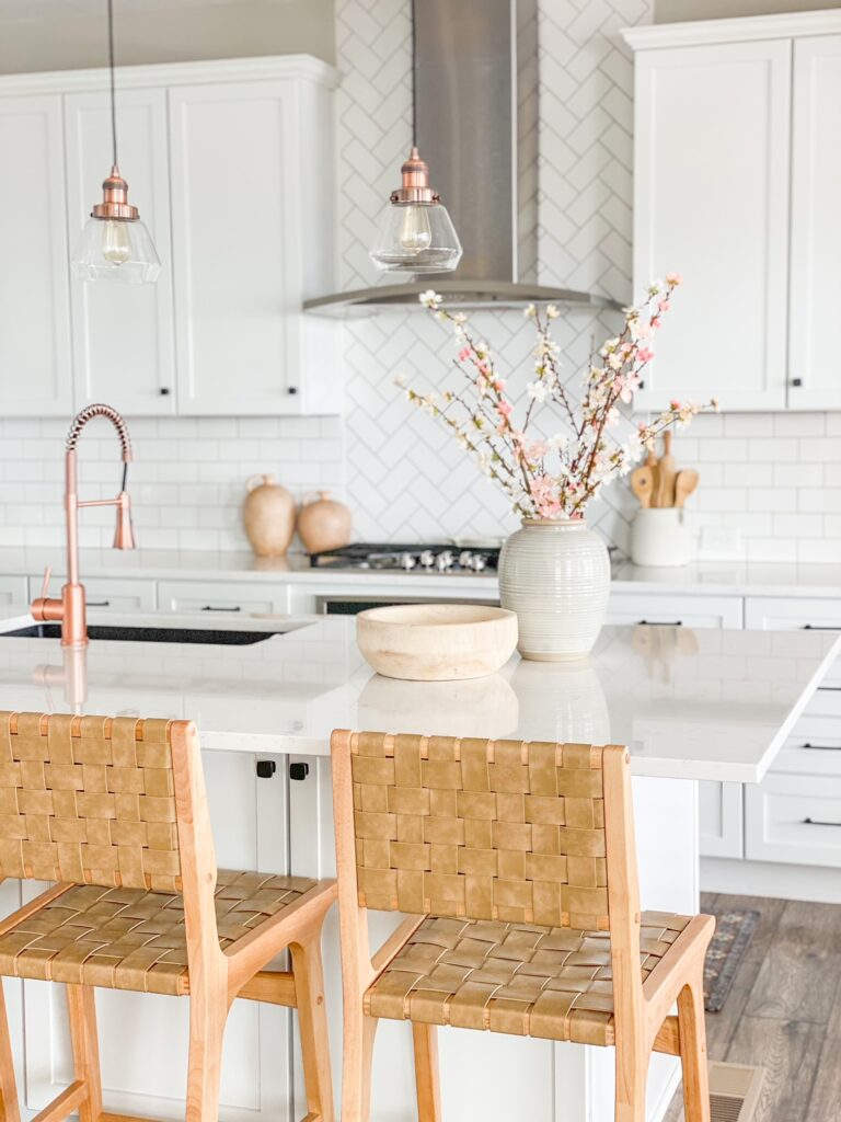 Spring florals add a pop of color to al all white kitchen!
