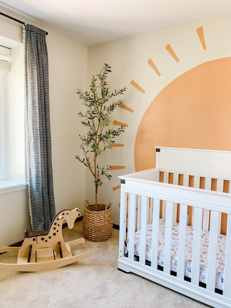 Boho Gender Neutral Nursery decor with faux olive tree and sun mural