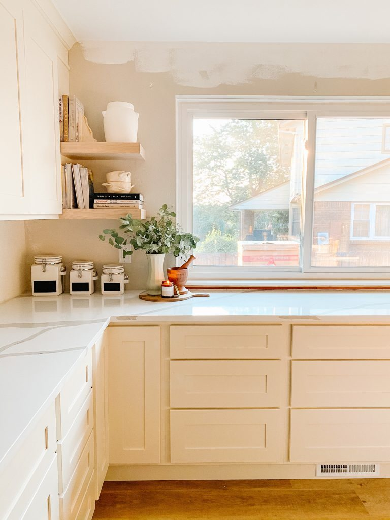 kitchen remodel with quartz counters and open shelving
