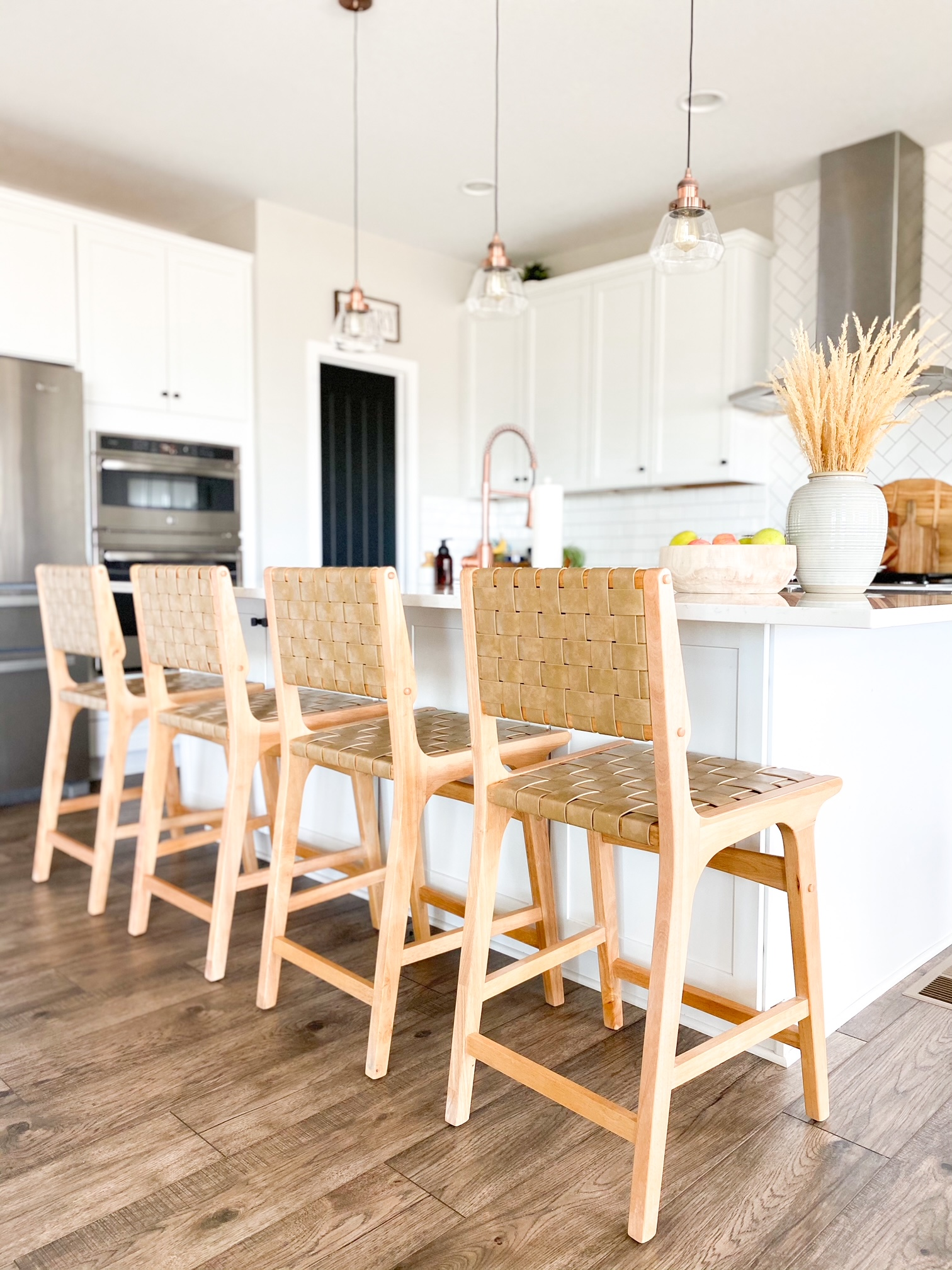 boho bar stools in an all white kitchen