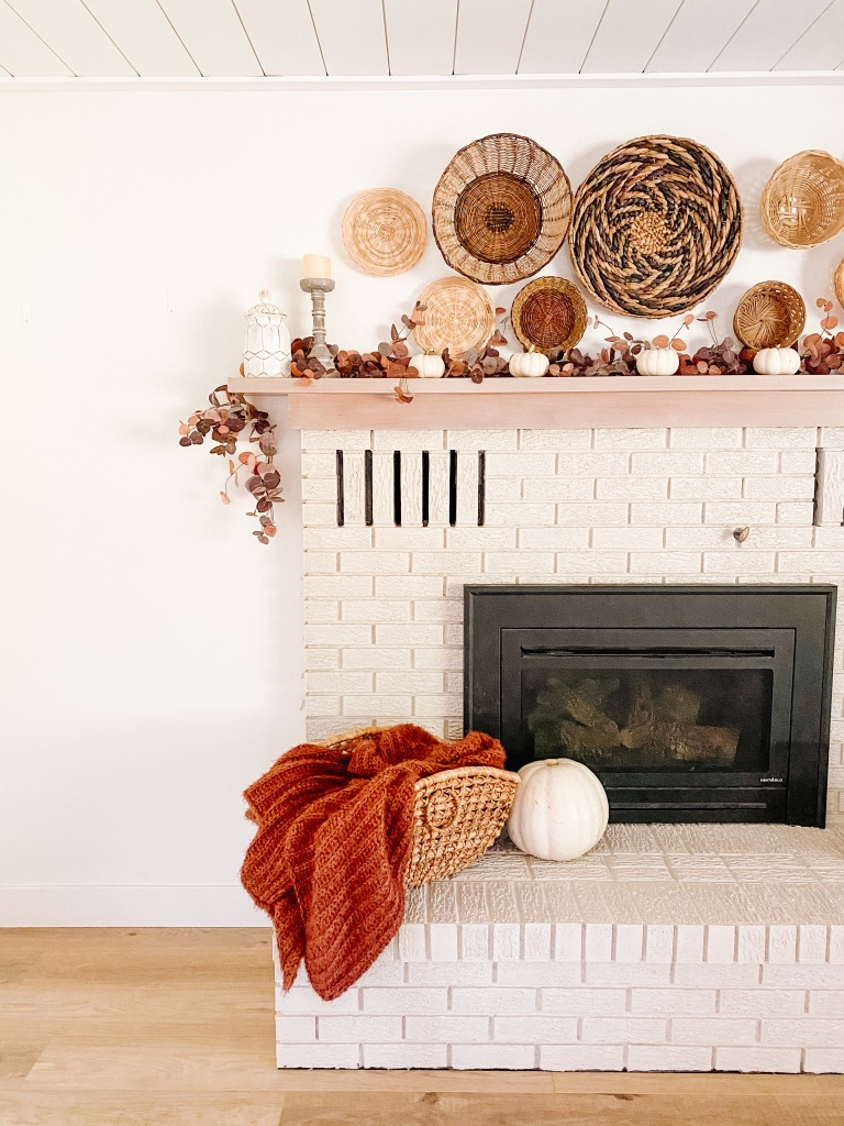 simple fall fireplace mantel with rust throw and baskets