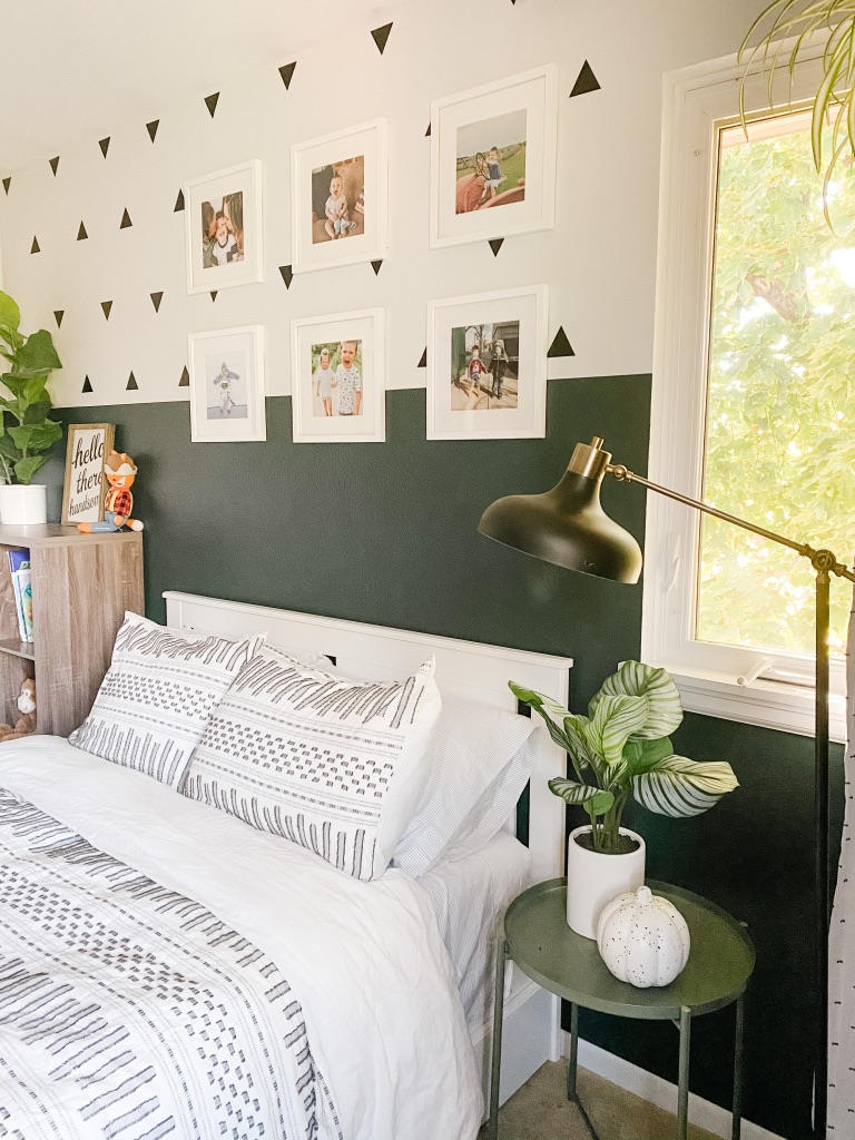 boho boy bedroom with colorblock green and white wall and white frame gallery wall