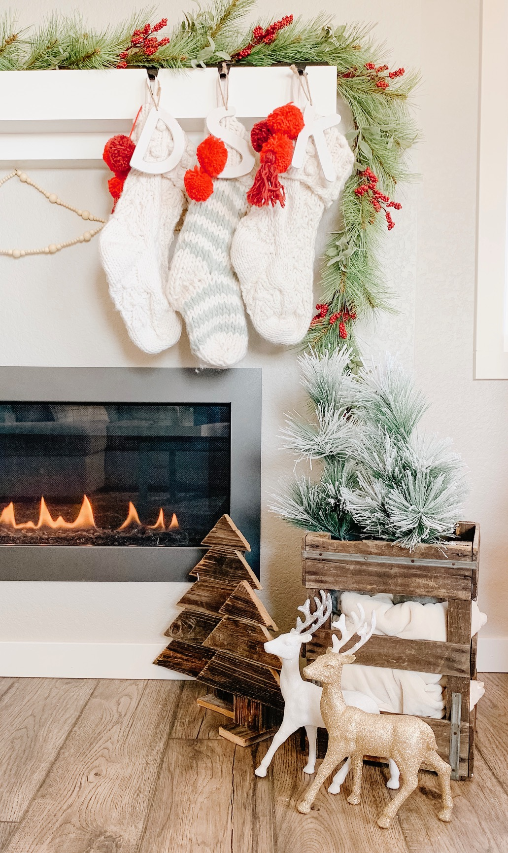 christmas fireplace mantel with stockings and bead garland