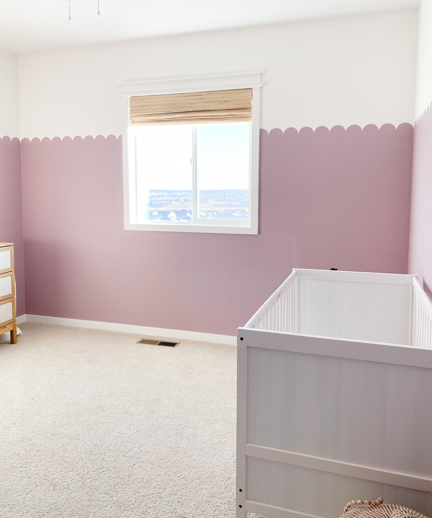 nursery with purple scalloped wall