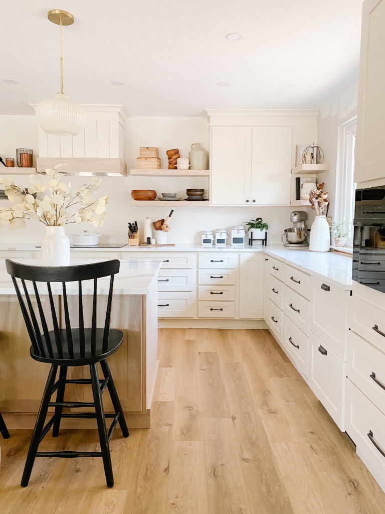 Provenza LVP floors in updated kitchen with white cabinets and quartz countertops