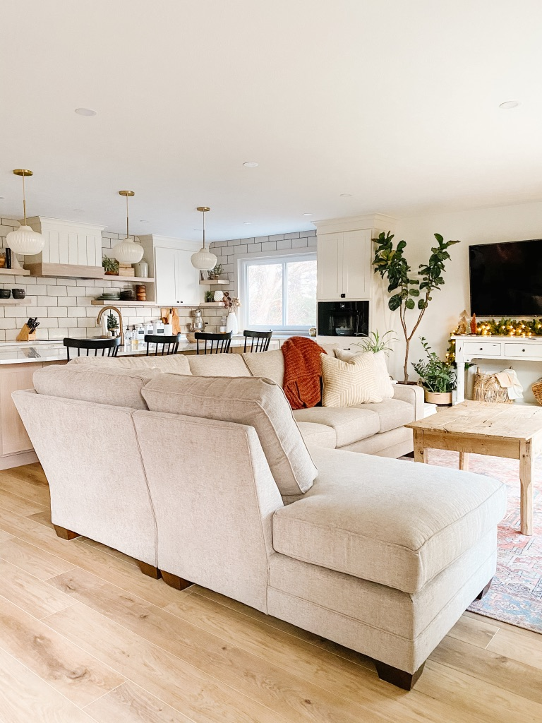 Woodley's Fine Furniture Review with King Hickory Sectional in neutral boho living room with loloi terra cotta area rug