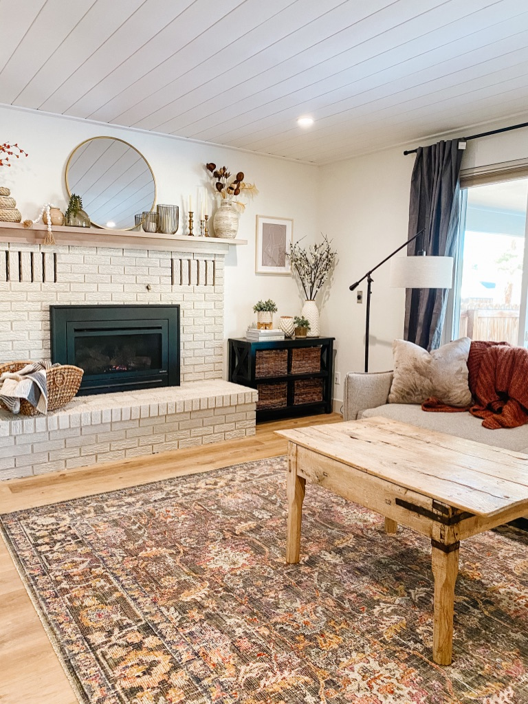 loloi chris loves julia rosemarie stone multi area rug in modern boho living room with painted brick fireplace