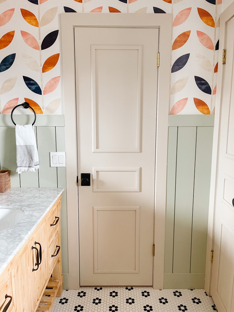 how to majorly update flat panel doors on a budget with wood moulding and paint