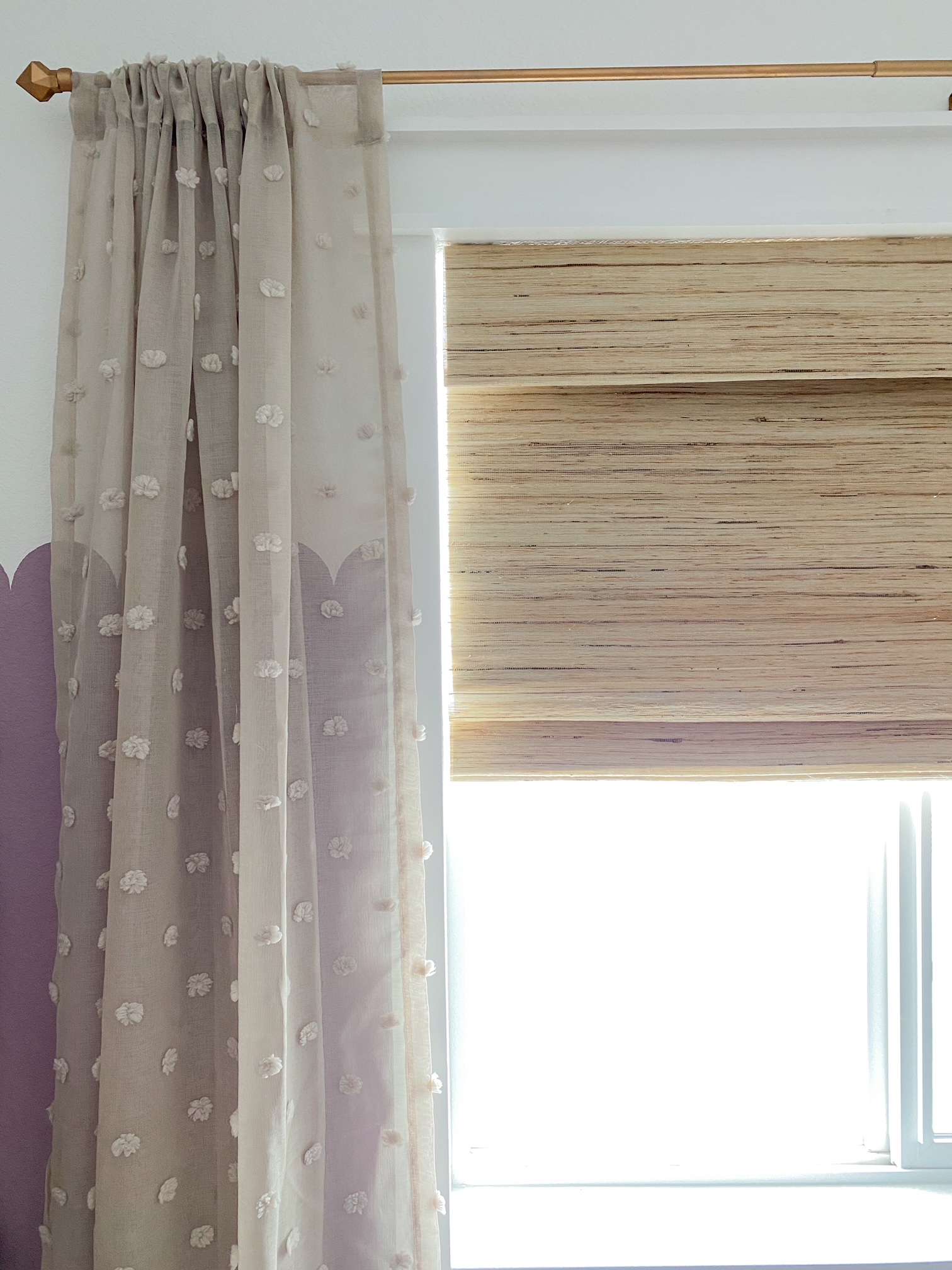 Affordable Amazon curtains in nursery with a woven roman shade!