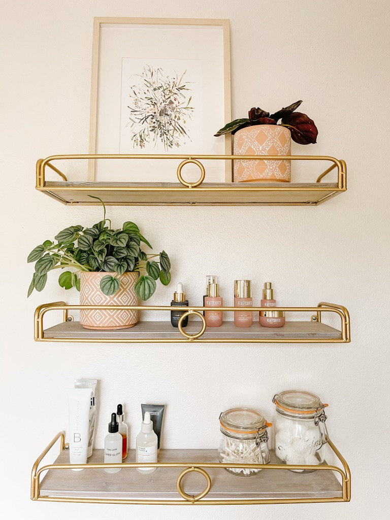add decorative gold bathroom shelves to give your small bathroom an affordable update