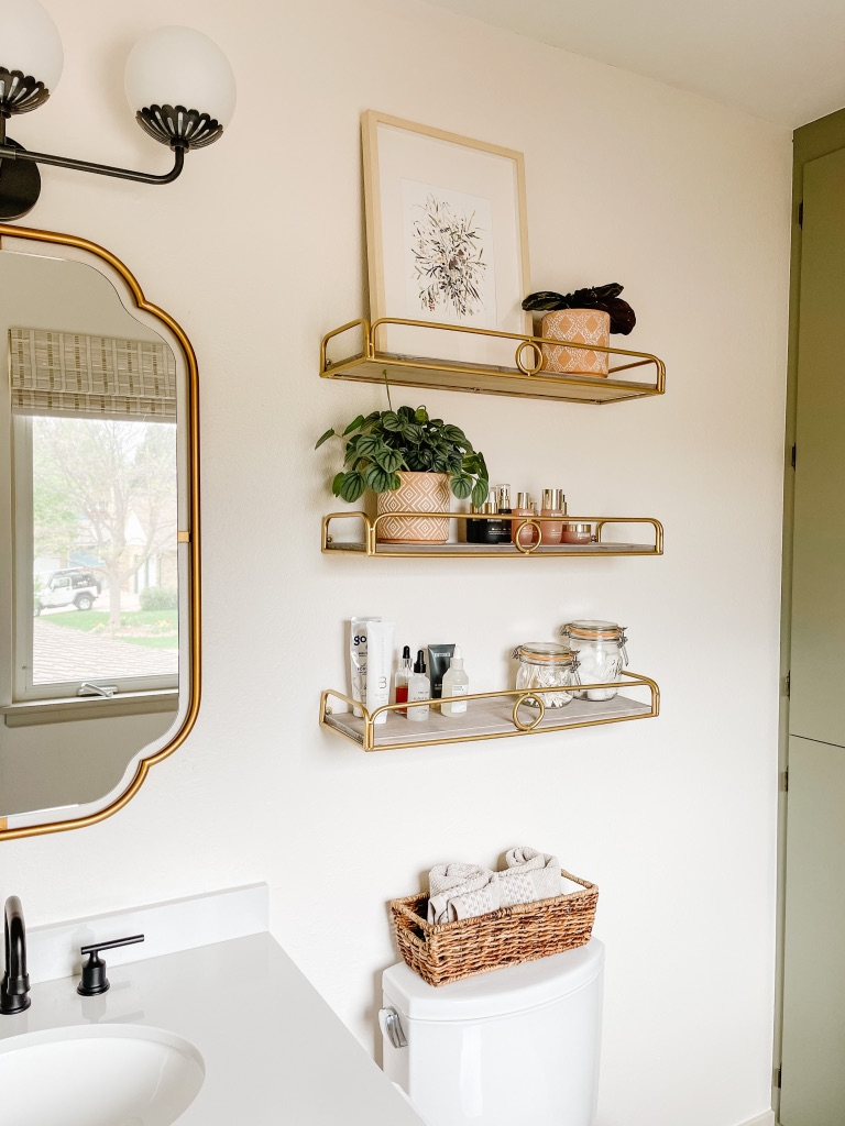 decorative gold and wood bathroom shelves and bath accessories