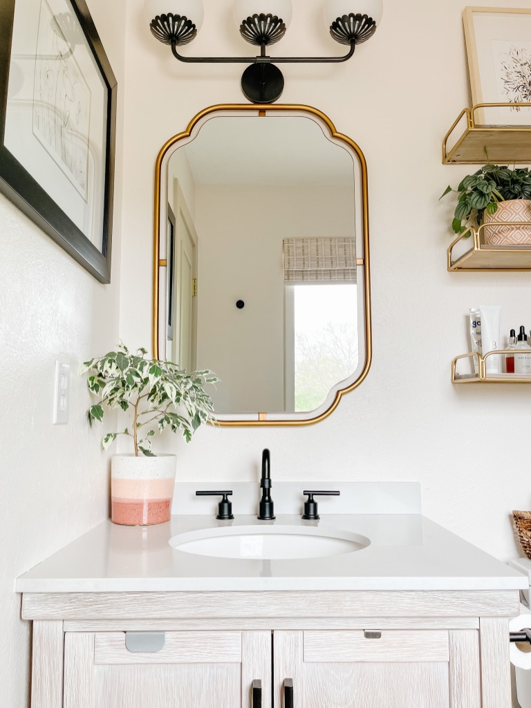 how to update your small master bath with a new vanity mirror from anthropologie
