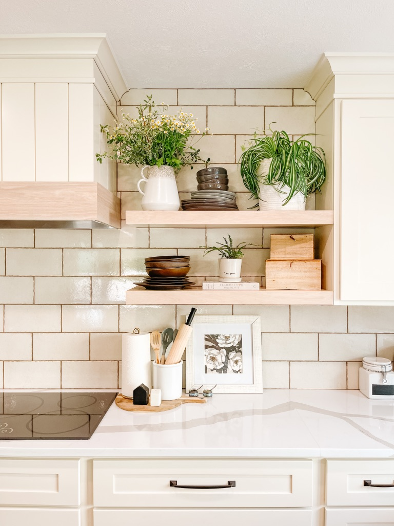 kitchen remodel with beige subway tile backsplash and white oak floating shelves and custom hood cover with shiplap and wood accent