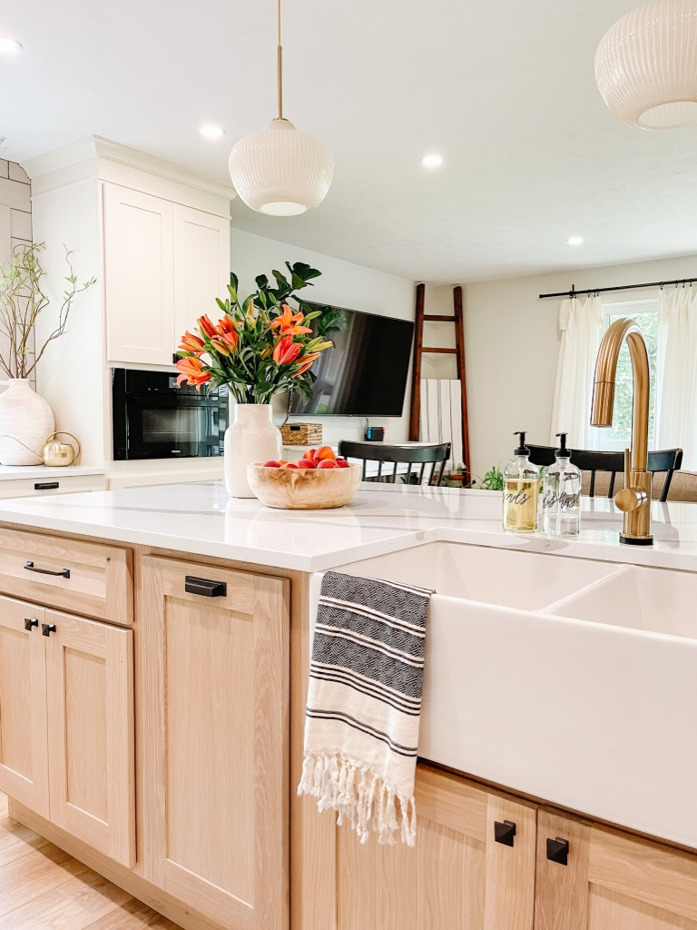 how to decorate your kitchen sink area with cute soap dispensers and neutral patterned turkish towels