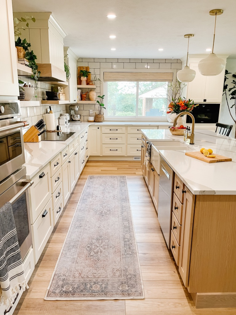 1970s kitchen remodel with cream cabinets and white oak island cabinets
