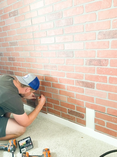 Installing, hanging and cutting faux brick paneling.