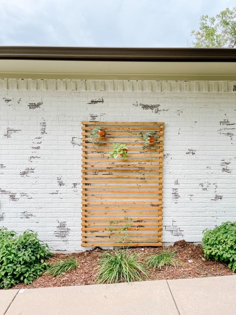 easy DIY wood trellis for a brick wall