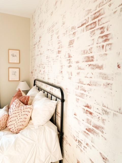 German schmear brick wall in bedroom.