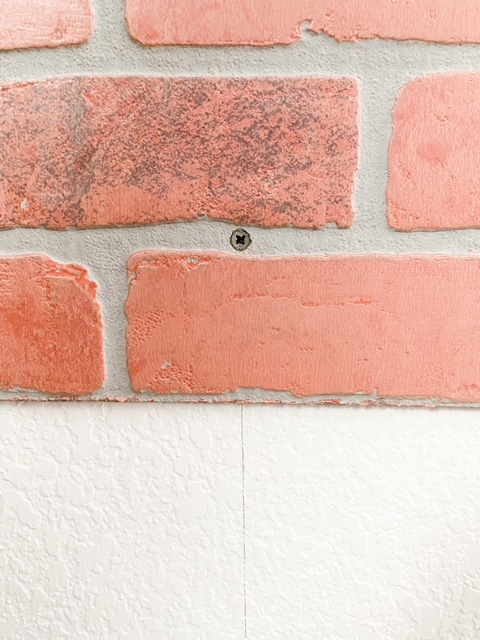 How to screw in a faux brick panel.