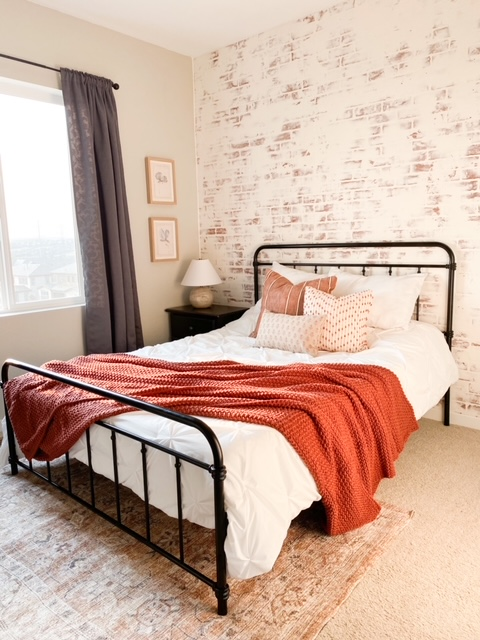 Guest bedroom with a German schmear faux brick wall.