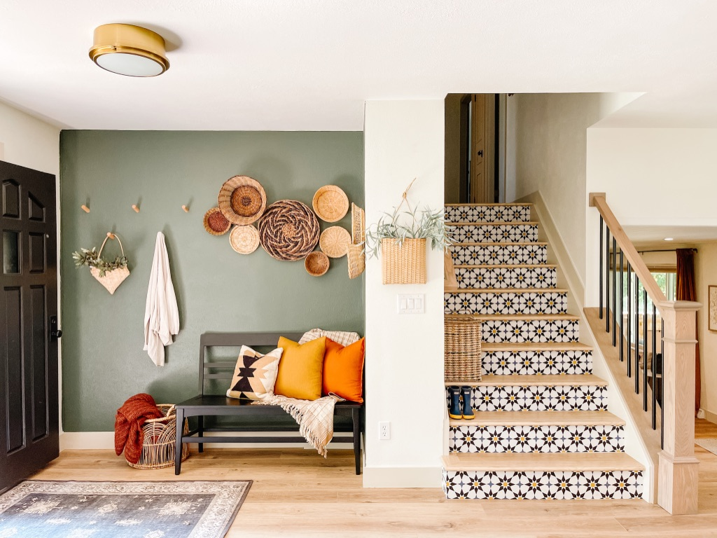 Colorful DIY Stair Risers with Peel and Stick Wallpaper and Dark Green Accent Wall